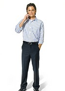 Portrait of a young man talking on a mobile phone and smiling