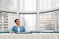 African businesswoman at table
