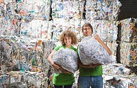 Man and woman at a recycling plant