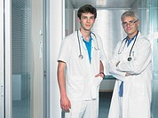 Two male doctors in hospital lobby