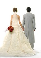 Rear view of a newlywed couple holding each other's hands