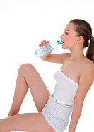 Side profile of a young woman drinking water from a water bottle