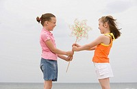 Young girls holding pinwheel