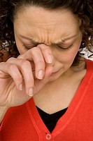 Woman wiping tears from her eyes