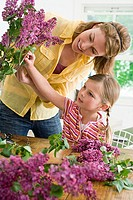 A mother and daughter flower arranging