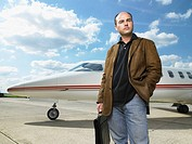 Man standing in front of private jet