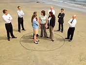 Group of businesspeople on the beach