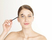 Woman with a eyebrow building brush