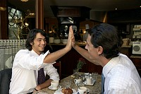 Businessmen giving a high five to each other