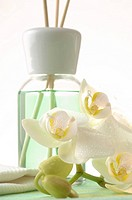 Aroma lamp with aroma sticks and orchid blossoms