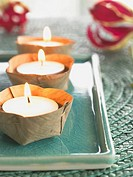 Small candles decorated on an Asian bowl