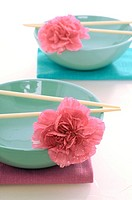 Asian bowls with chopsticks and blossoms