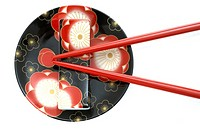 Plate with an Asian flower pattern and chopsticks