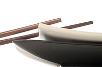 Chopsticks and white and black plates