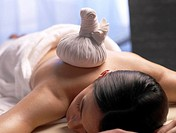 Woman get a massage with a compress (thumbnail)