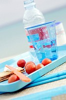 A glass of water, tomatoes and crispbread on a tray (thumbnail)