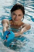 Woman with gloves in the water
