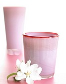 Pale pink glass vases with spiderwort blossom