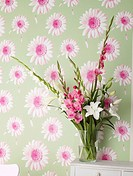 Bouquet and flowery wallpaper