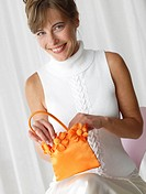Woman with an orange handbag