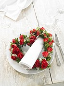 Napkin and a heartshape wreath of roses