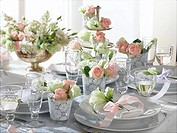 Romantic table decorated with roses and eustoma