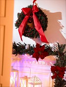 Advent wreath with a red ribbon hanging on the wall
