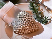 Napkin and a heart hanger embroided with pearls