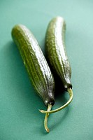 Cucumbers, green background