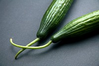 Cucumbers, black background
