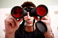 Man with binoculars in eyeglass store