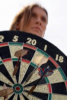 Closeup of woman holding dartboard