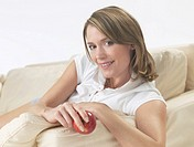 Woman on the sofa with an apple (thumbnail)