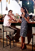 Couple in a bar, man smoking cigar (thumbnail)