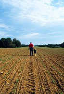 Agriculture - A farmer with his young son walks through his soybean field inspecting the crop / Mississippi, USA MR