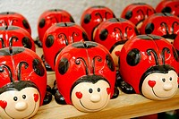 Ladybird money boxes. Garden Center. Cambrils. Tarragona province. Catalonia. Spain.