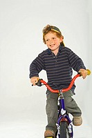 Boy riding a bicycle and smiling