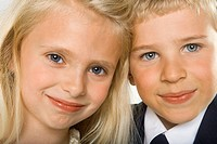 Portrait of a boy and a girl smiling