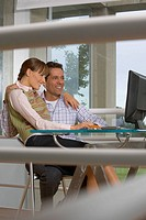 Couple looking at computer together (thumbnail)