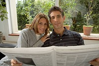 Couple reading newspaper together (thumbnail)