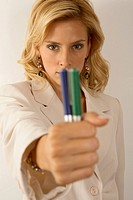 Portrait of a businesswoman holding pens