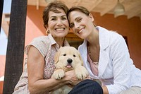 Mother and Daughter Portrait with puppy