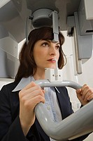 Close-up of a young woman going through a medical dental scan by a dental X-Ray equipment