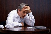 Close-up of a businessman looking depressed