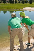 Rear view of a mid adult couple playing golf (thumbnail)