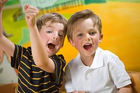 Portrait of two boys shouting