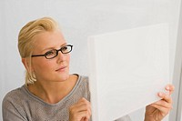 Close-up of a businesswoman looking at a blueprint