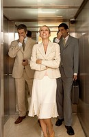 Businesswoman with two businessmen holding their noses in an elevator