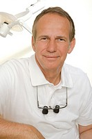 Portrait of a dentist smirking