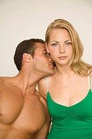Young man kissing a young woman